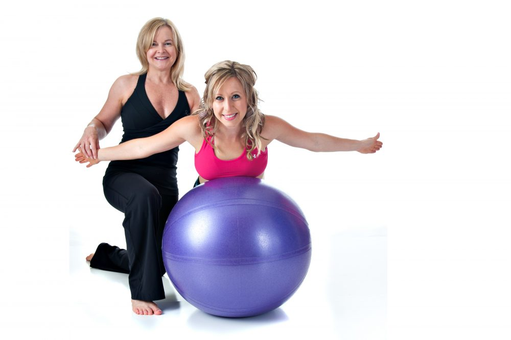 stretching on a ball at body innovations guelph