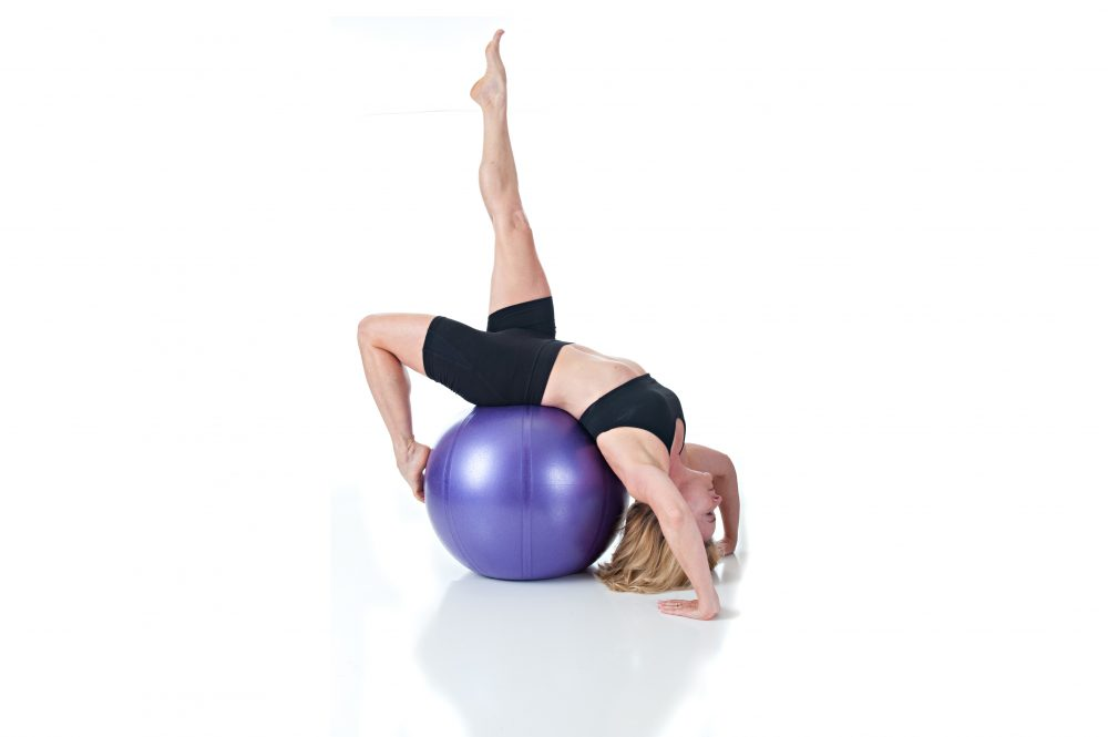 stretching on the ball at body innovations guelph